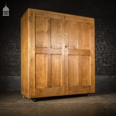 Large Early 20th C Solid Oak School Cupboard on Wheels Complete with Lock and Key