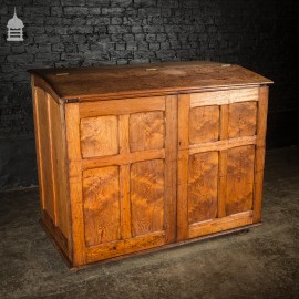 Large 19th C Figured Pitch Pine Ecclesiastical Cupboard with Double Doors, Opening Top and Metal Castors