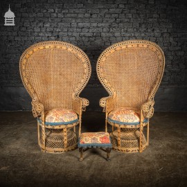 Pair of 1920s Cane Emmanuelle Peacock Chairs with Later Fabric Cushioned Seats and Footstool