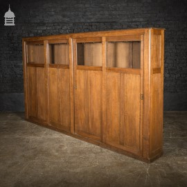 Glazed 1920's Oak Office Cloak Cupboard with Sliding Doors and Numbered Hooks