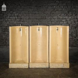 Bank of Three Cane Stonite Urinals 'The Beryl' by WR Pickup & Co LTD