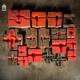 Collection of 18 Red and Black Industrial Factory Moulds