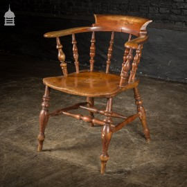 19th C Elm Captains Bow Seat Smokers Chair with Turned Arm Support and Double H Stretcher